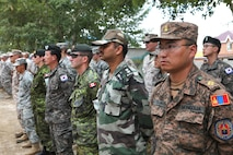 Military medical professionals from Mongolia, India, Canada, the Republic of Korea and the U.S. stand in a multilateral formation at the Cooperative Health Engagement and Subject Matter Expert Exchange closing ceremony in Nalaikh district, Ulaanbaatar, Mongolia, Aug. 13. The medical portion of this year's Khaan Quest exercise expanded on those of previous exercises by striking more of a balance between classroom learning and practical experience, giving the multinational team of doctors an opportunity to work together through real-life, clinical situations. Khaan Quest is an annual peacekeeping operations-focused, combined training exercise hosted annually by the Mongolian Armed Forces, and co-sponsored by U.S. Army Pacific and U.S. Marine Corps Forces, Pacific. MARFORPAC served as the U.S. executive agent for Khaan Quest 2013.