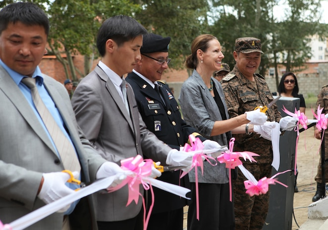 "(From right) Maj. Gen. B. Bayarmagnai, deputy chief of general staff for the Mongolian Armed Forces, U.S. Ambassador to Mongolia Piper Campbell and Maj. Gen. Gary Hara, deputy commanding general of the Army National Guard for U.S. Army Pacific, cut the ribbon for newly renovated Erdmiin Orgil School in Nalaikh district, Ulaanbaatar, Mongolia, Aug. 13. The project took place as part of exercise Khaan Quest 2013. Engineers from the U.S., Mongolia and Canada worked side-by-side to replace the roof, windows, front stairs and interior doors, ""re-stucco"" the exterior walls, apply emulsion and repaint the building. They also tore down a structurally unsound concrete awning at the main entrance and built a handicap-accessible ramp at the front of the school."