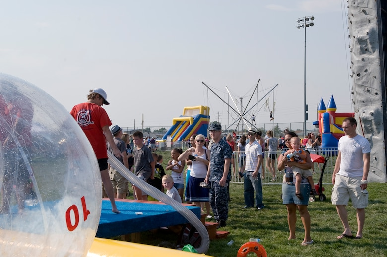 Members of Team Buckley participate in various events during Fun Fest Aug. 13, 2013, at the softball fields on Buckley Air Force Base, Colo. Fun Fest is an annual Buckley birthday celebration which includes a day full of field-day activities and a community fair. (U.S. Air Force photo by Senior Airman Phillip Houk/Released)