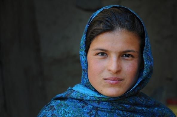 Lamia, the namesake of the Lamia Afghan Foundation, a non-profit organization found by retired Lt. Gen. John and Jan Bradley, poses for a photo during one of the Bradleys trips. They met in 2007 when Lamia pushed her way through a crowd to as a 9-year-old to ask the general for a pair of boots for her cold feet. The Bradleys have collected and delivered more than two million pounds of aid for  Afghanistan Mid-January 2010. In all, the Bradleys are working on building the seventh school and have collected and delivered more than two million pounds of supplies. (Courtesy photo)