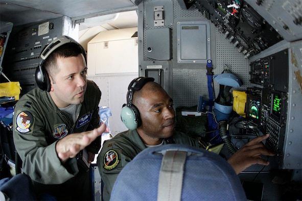 Capt. Ashlyn Smith, a navigator with the 966th Airborne Air Control Squadron, answers a question during a check ride with reservist Maj. Antwaun Hunter, 970th AACS. Major Hunter is temporarily assigned to the active-duty 966th to help train student navigators on the E-3 Sentry aircraft. (Air Force photo by Staff Sgt. Caleb Wanzer)