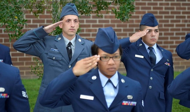 Bulgarian air force Cpl. Stoyko V. Stoykov salutes with U.S. Airmen and classmates August 15, 2013, during a reveille ceremony at McGhee Tyson Air National Guard Base, Tenn. Stoykov graduated from Airman Leadership School along with Bulgarian Sergeant Yordanka S. Petrova-Angelova, who graduated from the NCO Academy, as a result of international relations built through the Tennessee National Guard State Partnership Program.