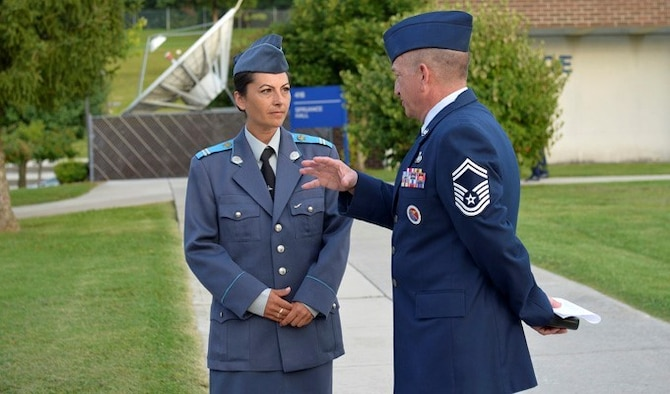 Bulgarian air force Sgt. Yordanka S. Petrova-Angelova (left) talks with Senior Master Sgt. Andrew Traugot, August 15, 2013, at McGhee Tyson Air National Guard Base, Tenn. Petrova-Angelova graduated from the U.S. Air Force NCO Academy along with Bulgarian Cpl. Stoyko V. Stoykov, who attended Airman Leadership School at around the same time. The bulgarian airmen completed the leadership education this summer as part of relations built through the Tennessee National Guard State Partnership Program. Traugot is the director of education, Satellite EPME at the I.G. Brown Training and Education Center.