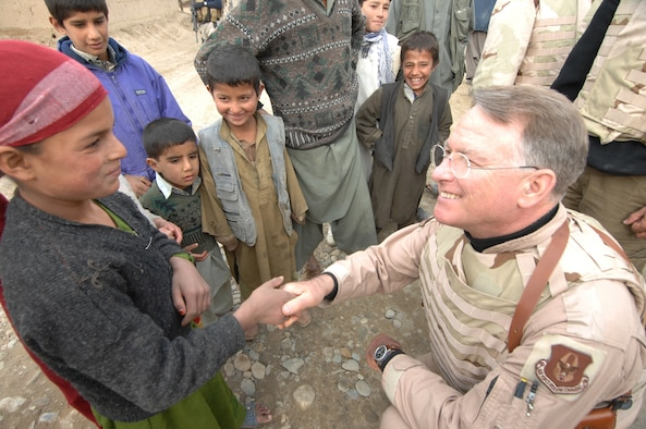 Lt. Gen. John Bradley meets Lamia for the first time in December 2007. Since that first meeting, the now retired general and his wife, Jan, started a non-profit organization in Lamia's honor, the Lamia Afghan Foundation. The Bradleys have made seven trips to Afghanistan to build schools and deliver humanitarian supplies. (U.S. Air Force photo/Tech. Sgt. Rick Sforza)