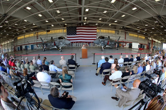 Distinguished guests of the South Carolina community listen in as Maj. Gen. Robert F. Hedelund, the commanding general of 2nd Marine Aircraft Wing, debuts the F-35B Lightning II Joint Strike Fighter to the community during a showcase of the aircraft aboard Marine Corps Air Station Beaufort, Aug. 20. The F-35 will replace the Marine Corps' aging legacy tactical fleet providing the dominant, multi-role, fifth-generation capabilities needed across the full spectrum of combat operations to deter potential adversaries and enable future naval aviation power projection. MCAS Beaufort is expected to receive the aircraft in 2014 along with Marine Fighter Attack Training Squadron 501, the Marine Corps' first F-35B training squadron, which falls under the command of Marine Aircraft Group 31 aboard MCAS Beaufort.