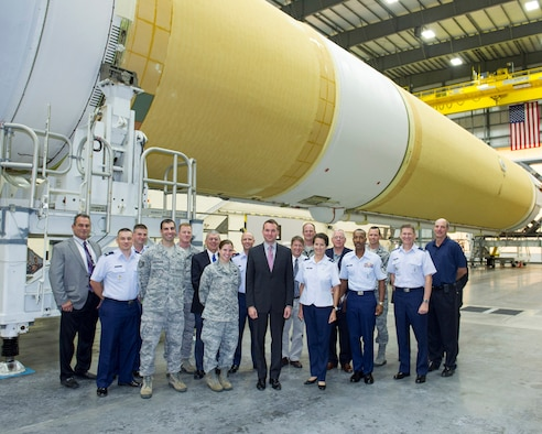 Acting Secretary of the Air Force Eric Fanning poses with Brig. Gen. Nina Armagno (right), 45th Space Wing commander, in front of a Delta IV launch vehicle during his tour of the Horizontal Integration Facility at Cape Canaveral Air Force Station Aug. 8, 2013, given by 1st Lt. Danielle DePaolis, 5th Space Launch Squadron engineer (left of Fanning). (U.S. Air Force photo/Matthew Jurgens)
