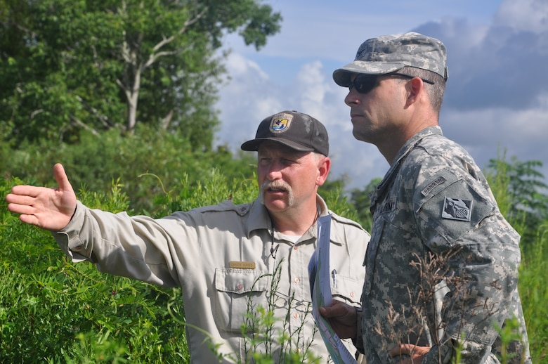 Chuck Hayes, supervisory wildlife biologist with the U.S. Fish and Wildlife Service, speaks with Col. Thomas J. Tickner, commander of the U.S. Army Corps of Engineers, during a visit to the Savannah National Wildlife Refuge, Aug. 19, 2013. Established in 1927 and operated by the U.S. Fish and Wildlife Service, the refuge provides more than 29,000 acres of freshwater marshes, tidal rivers and bottomland hardwood habitat. The Corps has performed several projects for the refuge, including a series of freshwater control structures completed in 2010. As a federal partner, the Corps often consults with the FWS when making water management decisions affecting the Savannah River Basin. The FWS is also a cooperating federal agency in the Savannah Harbor Expansion Project.