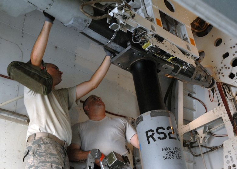 U.S. Air Force Staff Sgts. Andrew Eudey, left, and Lyle Eagan, 7th Munitions Squadron load crew members, load a GBU-54 on to a 10-carry bomb module on the B-1 during a practice load Aug. 8, 2013, on Dyess Air Force Base, Texas. Knowing the B-1's weapons system is important because it is the load crew member's job to understand the way the weapons work from start to finish. (U.S. Air Force photo by Senior Airman Shannon Hall/Released)