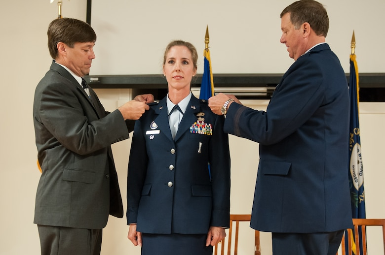 Col. Kathryn Pfeifer, director of staff for Headquarters, Kentucky Air National Guard, is promoted to the rank of colonel during a ceremony held Aug. 17, 2013, at the Kentucky Air National Guard Base in Louisville, Ky. Pfeifer is the first female line office to attain the rank of colonel in the Kentucky Air National Guard. (U.S. Air National Guard photo by Senior Airman Vicky Spesard)
