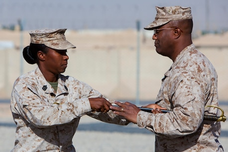 U.S. Marine Sgt. Maj. Lanette Wright (left), regimental sergeant major of Combat Logistics Battalion 8, Combat Logistics Regiment 2, Regional Command (Southwest), hands the sword of office to Col. Dwayne Whiteside, commanding officer of CLR-2, during their Relief and Appointment ceremony on Camp Leatherneck, Helmand province, Afghanistan, July 25, 2013. The Marines and sailors of Combat Logistics Battalion 6 replaced Combat Logistics Battalion 8 in supporting combat operations during Operation Enduring Freedom. (U.S. Marine Corps photo by Sgt. Anthony L. Ortiz / Released)