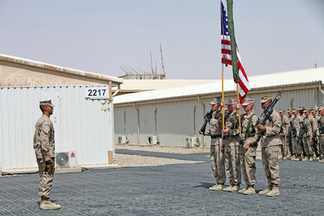 Marines with Regimental Combat Team 7 stand at attention after the unit flag was encased during a ceremony here, July 31, 2013. Afghan National Security Forces have taken control of combat operations throughout Helmand, which has eliminated the need for a Marine infantry regimental headquarters. RCT-7 has now officially turned over its responsibilities to Regional Command (Southwest).