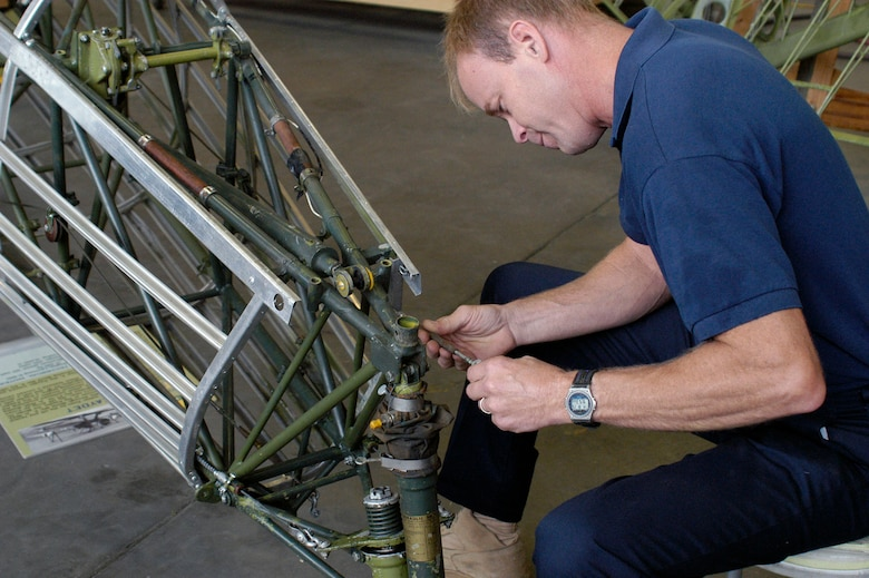 DAYTON, Ohio (08/2013) -- National Museum of the U.S. Air Force restoration specialist Brian Lindamood works on the Stearman PT-13D Kaydet. (U.S. Air Force photo)