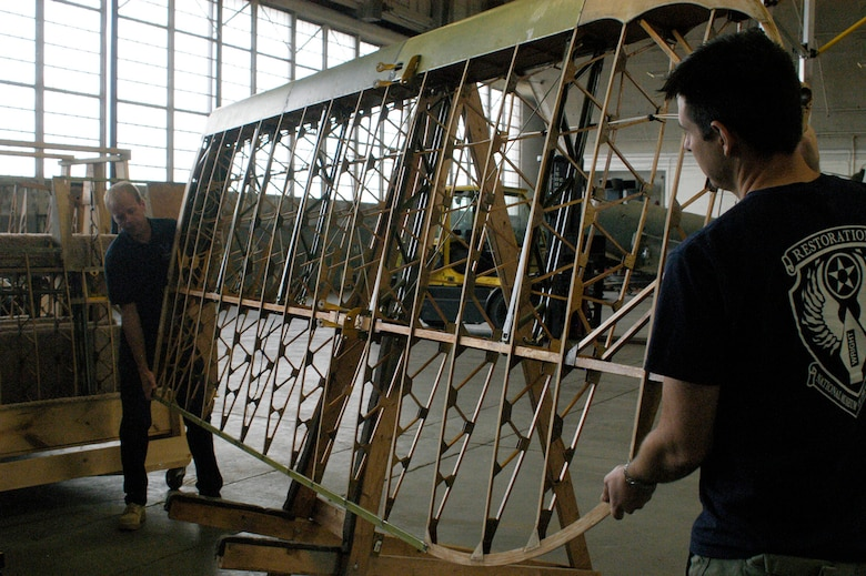 DAYTON, Ohio (08/2013) -- National Museum of the U.S. Air Force restoration specialists Brian Lindamood (left) and Casey Simmons lift one of the wings from the Stearman PT-13D Kaydet. (U.S. Air Force photo)