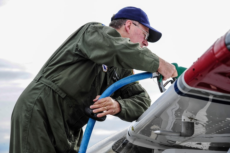 """Mark Biron, Civil Air Patrol 71st Composite Squadron member, refuels a CAP Cessna 172 after a RED FLAG-Alaska 13-3 sortie Aug. 19, 2013, Eielson Air Force Base, Alaska. The 71st CS flew multiple sorties during RF-A 13-3, simulating low-flying threats and """"attacking"""" various locations throughout the Joint Pacific Alaska Range Complex. (U.S. Air Force photo by Senior Airman Zachary Perras)"""