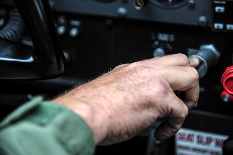 Mark Biron, Civil Air Patrol 71st Composite Squadron member, controls the throttle of a CAP Cessna 172 during a RED FLAG-Alaska 13-3 sortie Aug. 19, 2013. Eielson Air Force Base, Alaska, hosts the 71st CS, which participates in various exercises such as RF-A to assist participating units. (U.S. Air Force photo by Senior Airman Zachary Perras/Released)