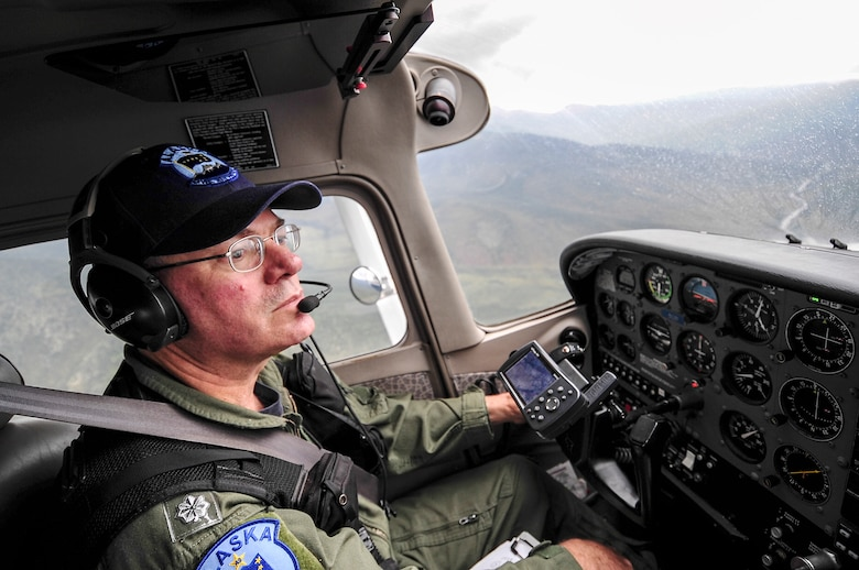 Mark Biron, Civil Air Patrol 71st Composite Squadron member, pilots a CAP Cessna 172 over the Joint Pacific Alaska Range Complex during RED FLAG-Alaska 13-3 Aug. 19, 2013. The 71st CS participated during RF-A, simulating low-flying threats for participating blue forces. (U.S. Air Force photo by Senior Airman Zachary Perras/Released)