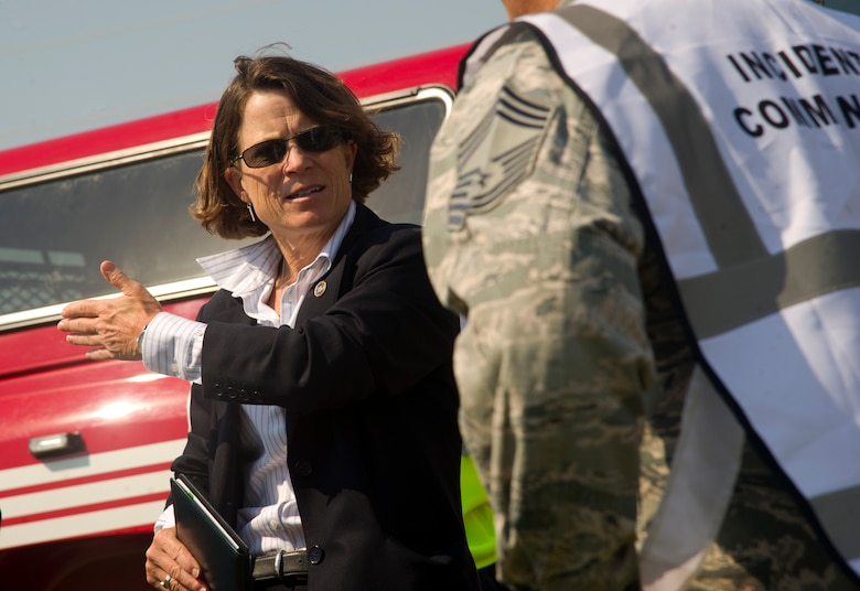 An agent from the Federal Bureau of Investigations speaks with the incident commander during a field training exercise at Minot Air Force Base, N.D., Aug. 20, 2013. The purpose of the exercise was to evaluate and validate the integration and response of emergency management, security forces, fire department, medical and missile field operations to an incident. (U.S. Air Force photo/Senior Airman Brittany Y. Auld)