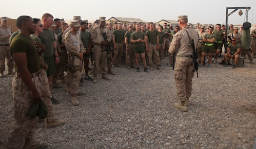 """Marines with 2nd Battalion, 8th Marine Regiment, Regimental Combat Team 7, gather at the Harvest Falcon Gym July 23 to watch the strong man competition. """"Our goal was to boost the morale of the Marines, while trying to keep them motivated and encourage physical fitness,"""" said Sgt. Joseph Jennings, 27, the company police sergeant with Headquarters and Service Company. """"I only expected a few people show up, but the turnout was much better than I thought it would be."""""""