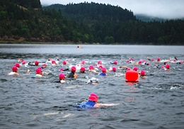 Swimmers compete in the triathlon at Cottage Grove Lake.