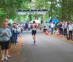 "Hundreds of spectators attend the ""Tri at the Grove"" to cheer on their friends and family members."