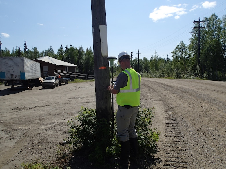 Tatton Suter, plan formulator in the Alaska District Civil Works Branch, records high water marks that occurred May 29 using a GPS rover system. This phase of the project was coordinated through the Alaska District Floodplain Management Program at the request of the state. High water marks were used by the Corps for a baseline structure elevation study.
