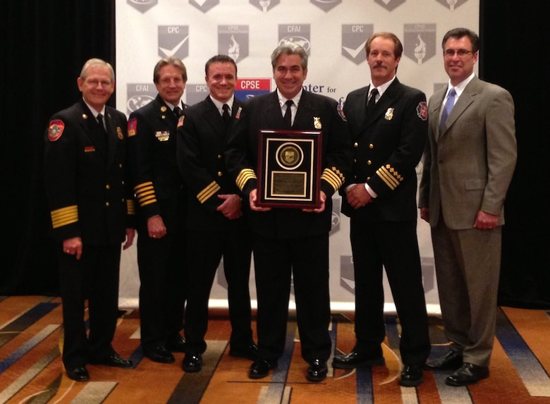 Buckley Fire and Emergency Services members receive an accredited agency plaque from Commission on Fire Accreditation International members Aug. 15, 2013, in Chicago. The department is one of only 150 international agencies and eight Air Force installations to achieve the accredited agency status with the CFAI and the Center for Public Safety Excellence. (Courtesy Photo)