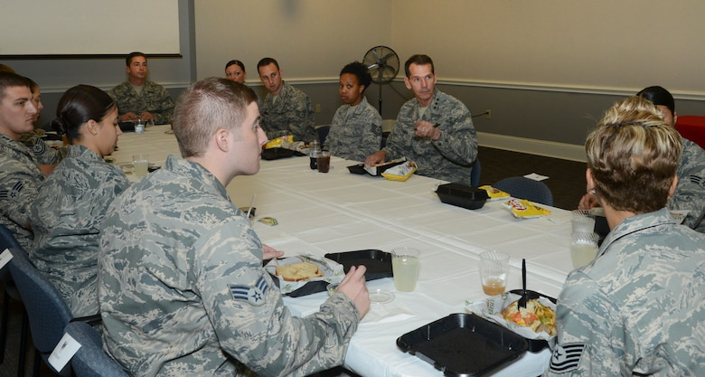 Lt. Gen. Stanley Clarke, director, Air National Guard eats lunch with the Airmen of the 136th Airlift Wing, Texas Air National Guard while listening to the Airmen's concerns during his site visit at Naval Air Station Fort Worth Joint Reserve Base, Aug. 21, 2013. Lt. Gen. Clarke gave the Airmen a challenge to mentor others and serve with distinction. (Air National Guard photo by Senior Master Sgt. Elizabeth Gilbert/released)