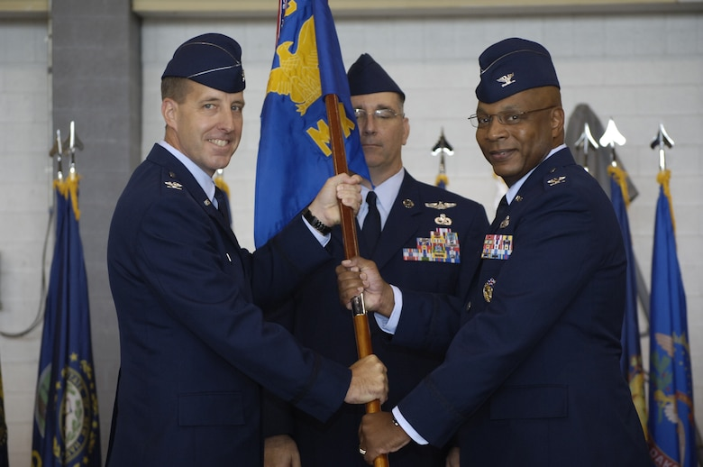 Col. André L. Kennedy, right, accepts command of the 552nd Maintenance Group from 552nd Air Control Wing Commander Col. Jay Bickley during an Aug. 13 ceremony. Colonel Kennedy replaces Col. Stella Smith, who retired after a 24-year Air Force career. (Air Force photo by Darren D. Heusel)
