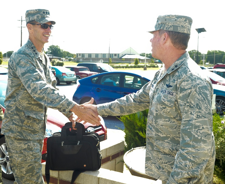 Major Gen. John Nichols, Adjutant General for Texas, greets Lt. Gen. Stanley Clarke, director, Air National Guard during his site visit to the 136th Airlift Wing, Texas Air National Guard at Naval Air Station Fort Worth Joint Reserve Base, Aug. 21, 2013. This is Lt. Gen. Clarke's first visit to the Wing since his appointment as the director of ANG. (Air National Guard photo by Senior Master Sgt. Elizabeth Gilbert/released)