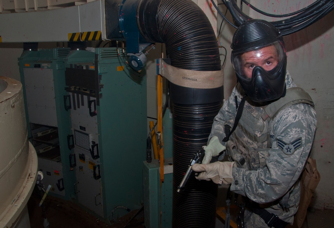 130814-F-BR137-433 Senior Airman Alec Griego, 790th Missile Security Forces Squadron, scours the inside of the Tango-09 Launch Facility for intruders during a training scenario Aug. 14, 2013. The scenario was part of an assaulter course meant to familiarize security forces and helicopter pilots with LF recapture scenarios. (U.S. Air Force photo by Airman 1st Class Jason Wiese)