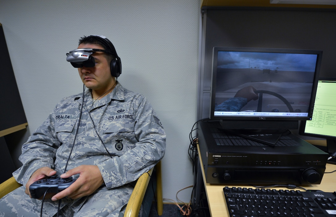 Staff Sgt. Louie Peralta, 86th Security Forces Squadron operations controller, utilizes a virtual reality trainer, Aug. 8, 2013, Ramstein Air Base, Germany. The 86th Medical Group offers virtual reality therapy in conjunction with traditional therapy to treat post-traumatic stress disorder. (U.S. Air Force photo/Airman 1st Class Jordan Castelan)