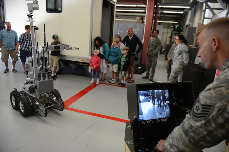 SPANGDAHLEM AIR BASE, Germany – U.S. Air Force Tech. Sgt. David Collins, 52nd Civil Engineer Squadron NCO in charge of Explosive Ordnance Disposal plans and intelligence from Pine Mountain Valley, Ga., demonstrates EOD capabilities for a base tour Aug. 16, 2013. Families of children who receive treatment at a local German hospital were shown around Spangdahlem AB to experience what it is like to be a Saber for a day. (U.S. Air Force photo by Airman 1st Class Gustavo Castillo/Released)