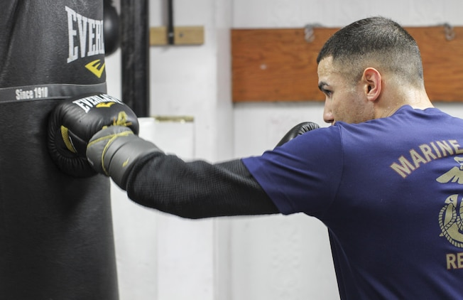 NEW YORK - Staff Sgt. Todd Dekinderen, a recruiter at Marine Corps Recruiting Substation Brooklyn, Recruiting Station New York, hits the heavy bag at the Sadam Ali Boxing Center in Brooklyn, Feb. 28.  Dekinderen is training with hopes of picking up where he left off and aspires to become a professional boxer.  (U.S. Marine Corps photo by Sgt. Kristin E. Moreno).