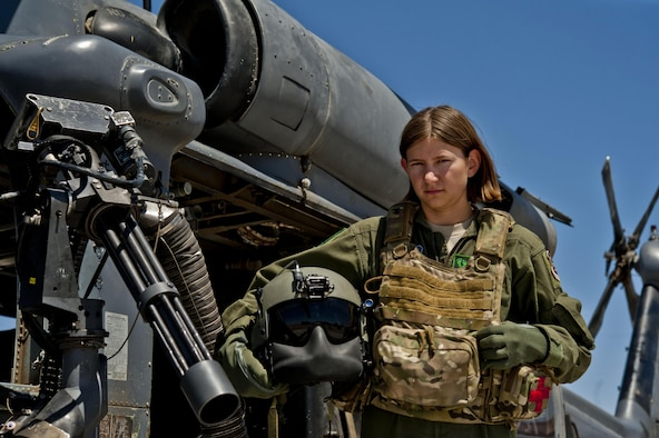 Airman 1st Class Natasha Libby, 66th Rescue Squadron aerial gunner, stands next to an HH-60 Pave Hawk June 20, 2013, at Nellis Air Force Base, Nev. Libby is the only female among more than 30 gunners assigned to the 66th RQS.
