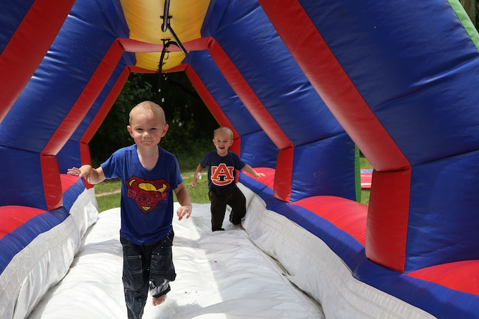 Titus, left, and Raiden, right, sons of Staff Sgt. Jared Hobbs, Marine Aviation Logistics Squadron 31 avionics work center supervisor, play during the squadron's family day held at the Air Station's log cabin, Aug. 16.