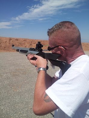 Maj. Andrew Green aims at a target during practice at the firing range at Kirtland Air Force Base, N.M. Green, assigned to the Air Force Nuclear Weapons Center, is a member of the Wounded Warrior Program training to make the shooting team for the 2014 Warrior Games.