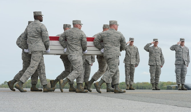 A carry team transfers the remains of a fallen Airman during a dignified transfer, April 30, 2013, at Dover Air Force Base, Del. A solemn dignified transfer of remains is conducted upon arrival at Dover AFB from the aircraft to a transfer vehicle to honor those who have given their lives in service to America.