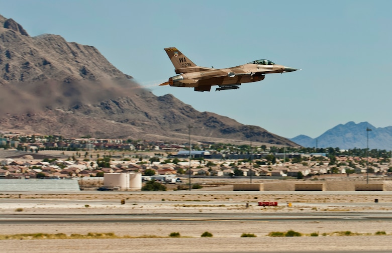 An F-16 Fighting Falcon assigned to the 64th Aggressor Squadron takes off for a training flight Aug. 13, 2013, at Nellis Air Force Base, Nev. Aggressor pilots use adversary tactics and act as hostile forces during air combat exercises. (U.S. Air Force photo/Airman 1st Class Joshua Kleinholz)