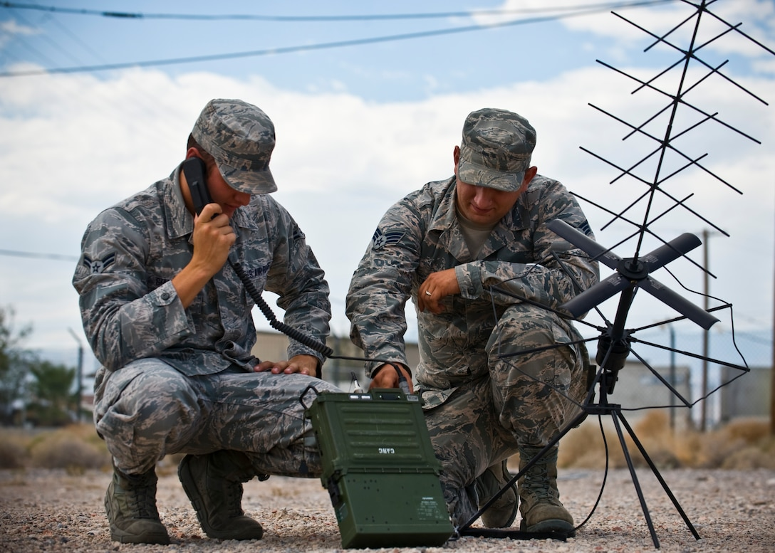 Airman 1st Class Anthony Giampapa and Senior Airman Brandon Lopez operate a mobile ground radio satellite system Aug. 15, 2013, at Nellis Air Force Base, Nev. The 99th Communications Squadron Airmen use mobile systems while at home station or deployed. Giampapa and Lopez are radio frequency transmissions systems journeymen. (U.S. Air Force photo/Senior Airman Brett Clashman)