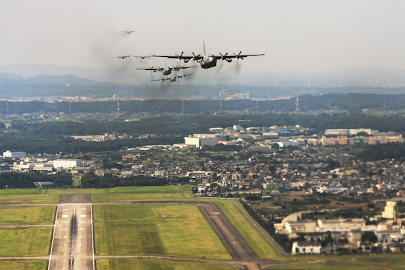 C-130 Hercules aircraft fly during a training mission above Yokota Air Base, Japan, Aug. 19, 2013. Seven C-130s flew in formation to practice airlift tactics and procedures. (U.S. Air Force photo/Osakabe Yasuo)
