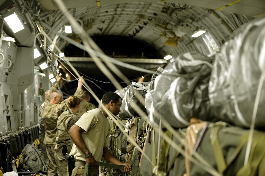 Senior Airman Shaun Larue inspects straps and riggers holding down cargo in a C-17 Globemaster III Aug. 21, 2013, at Bagram Airfield, Afghanistan. He is deployed from Pope Army Airfield, N.C. Larue is a 455th Expeditionary Operations Support Squadron joint airdrop inspection journeyman. (U.S. Air Force photo/Staff Sgt. Stephenie Wade)