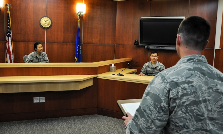 Maj. Hanna Yang, Buckley Legal Office deputy staff judge advocate, left, oversees a direct examination by Capt. Eric McCutchen, Buckley Legal Office chief of military justice, of Senior Airman Jose Sanchez, Buckley Legal Office paralegal, center, during training Aug. 21, 2013, at the legal office on Buckley Air Force Base, Colo. The legal office handled four courts-martial cases and five discharge boards last year. (U.S. Air Force photo by Staff Sgt. Nicholas Rau/Released)