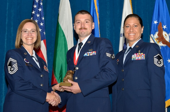 McGHEE TYSON AIR NATIONAL GUARD BASE, Tenn. - Senior Airman Jason G. Stark, right, from New York ANG, receives the academic achievement award for Airman Leadership School Class 13-6 at the I.G. Brown Training and Education Center here  from Senior Master Sgt. Paula C. Shawhan, EPME Director of Education, and Master Sgt. Veronica Ross, former Director of Education, Aug. 15, 2013. The academic achievement award denotes excellence as a scholar. It is based upon all summative objective tests and individual performance evaluations and is given to the student with the highest overall academic standing. (U.S. Air National Guard photo by Master Sgt. Kurt Skoglund/Released)