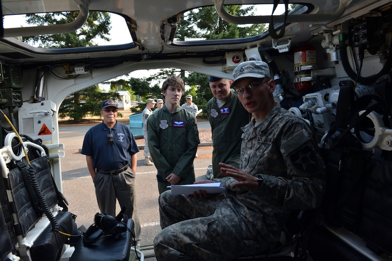 Christian Ball and Lt. Col. Matt Anderson, 4th Airlift Squadron commander, look inside a Stryker during Christian's Pilot for a Day visit Aug. 22, 2013 at Joint Base Lewis-McChord, Wash. This is the first time soldiers have paired up with Airmen for the Pilot for a Day program at Joint Base Lewis-McChord. (U.S. Air Force photo/Staff Sgt. Jason Truskowski)