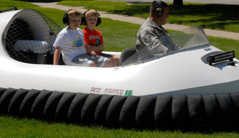 Children of Airmen from the 133rd Airlift Wing ride a hovercraft, one of many different activities offered during Family Day in St. Paul, Minn., Aug. 17, 2013. Family Day is an annual event that recognizes the families and thanks them for their support to the Airmen. (U.S. Air National Guard photo by Tech. Amy M. Lovgren/Released)