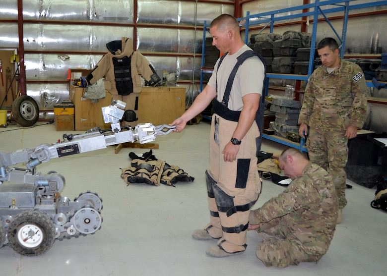 Master Sgt. Jeffery Prish is fitted for an explosive ordinance disposal bomb suit by Staff Sgt. Ryan Prince at the 64th Air Expeditionary Group in Southwest Asia, July 26, 2013. Prish is the 64th Expeditionary Support Squadron civil engineer operations superintendent deployed from Joint Base Charleston S.C., and hails from Mobile, Ala. Prince is a 64th ESS EOD craftsman deployed from Moody Air Force Base, Ga., and hails from Crystal Lake, Ill. (U.S Air Force photo/Staff Sgt. Minerva H. Rosario)