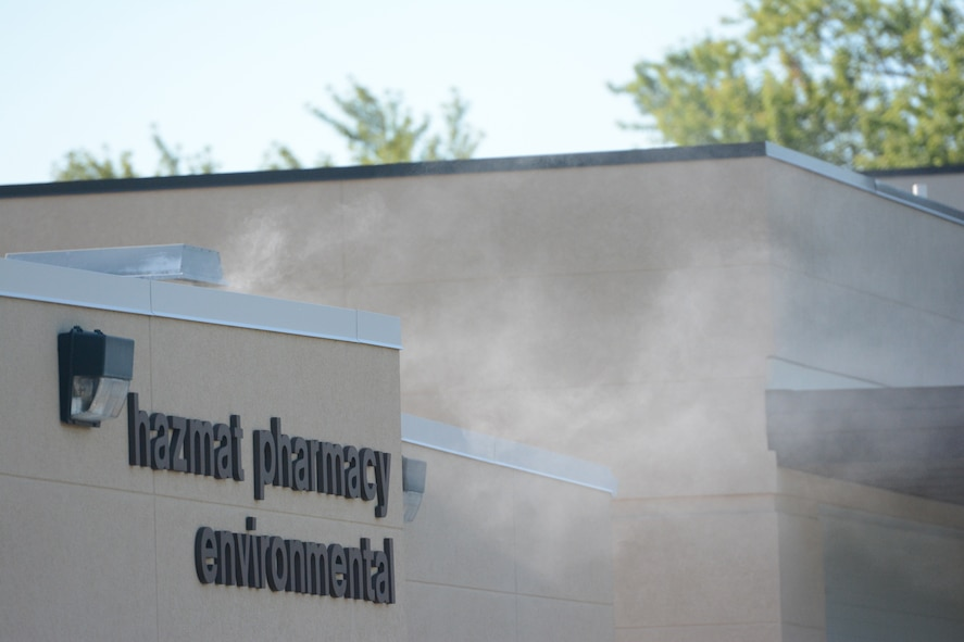 Smoke flowed from the front door of the Hazmat Pharmacy Environmental building during a bomb exercise at Truax Field, Madison, Wis., Aug. 23, 2013. The EOD team added realism by filling that building up with smoke, giving the rescue teams a challenge when removing the victims. The exercise was part of a new Air Force Inspection System initiative. (Air National Guard photo by Senior Airman Andrea F. Liechti)