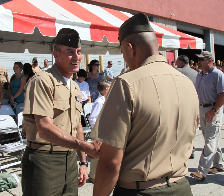 Brigadier Gen. James W. Lukeman, the 2nd Marine Division commanding general, congratulates Lt. Col. John L. Medeiros Jr., the 2nd Assault Amphibian Battalion commanding officer, after a change of command ceremony aboard Marine Corps Base Camp Lejeune, N.C., June 14, 2013. Medeiros began his career as a platoon commander with 2nd AA Bn.