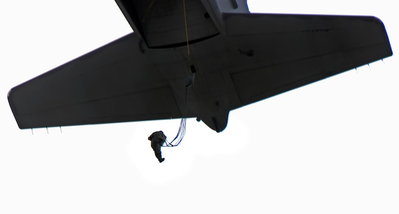 A member of the 736th Security Forces Squadron jump from a C-130 Hercules Aug. 21, 2013, during a static line jump training over Andersen Air Force Base, Guam. As the integrated force protection element of the 36th Contingency Response Group, members of the 736th SFS provide a quick-response airborne capability that serves as an advance echelon team for contingency and humanitarian missions all over the Asia-Pacific region