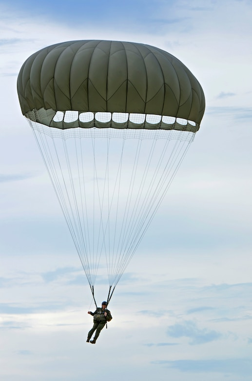 Staff Sgt. Daniel Guy, 736th Security Forces Squadron fire team leader, makes his way to the ground Aug. 21 after jumping from a C-130 Hercules over Andersen Air Force Base, Guam. Air Force static line capability falls under the personnel parachute program. Jumpers are first qualified during a three-week long basic airborne course at Ft. Benning, Ga., and then continue to work on their jumping proficiency and qualifications after they return here.